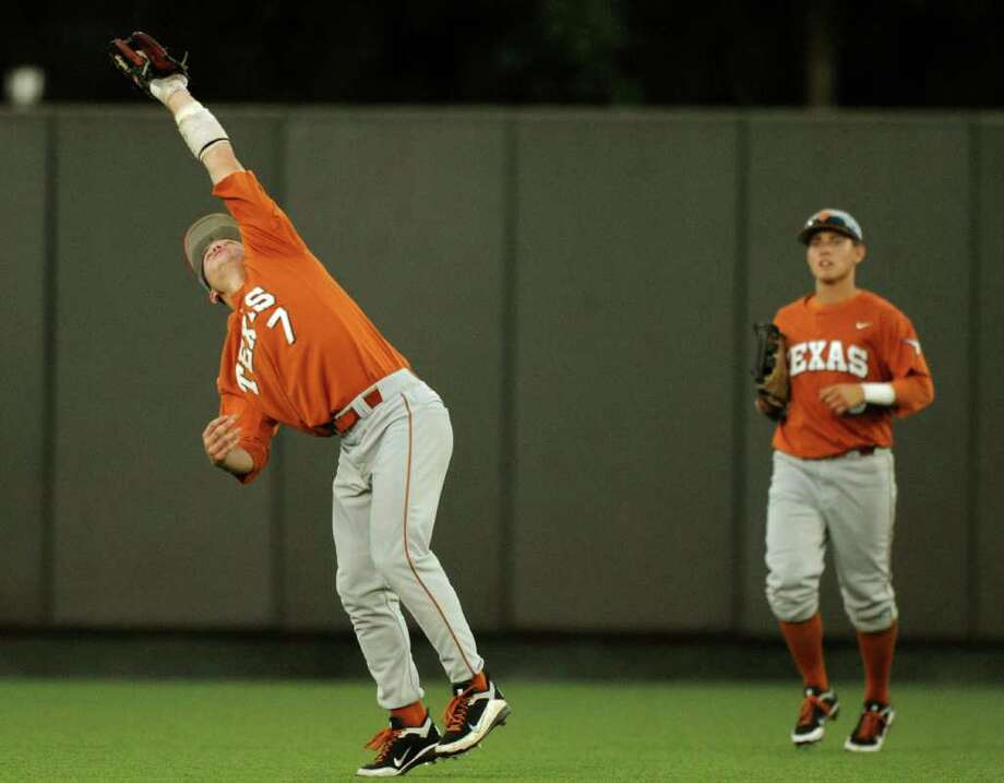 Texas shortstop Jordan Etier hauls in a blooper for an out during NCAA Baseball Austin Regional action against Kent State on Saturday, June 4, 2011. BILLY CALZADA / gcalzada@express-news.net Photo: BILLY CALZADA, Express-News / gcalzada@express-news.net