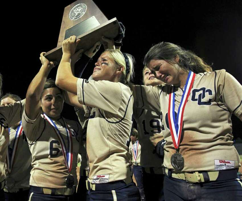 Brittany Stone grimmaces with teammate Katy Vandewater as they hoist their runner up trophy as O'Connor loses 7-5 to The Woodlands for the state 5A championship in softball at McCombs Field in Austin on June 4, 2011. Tom Reel/Staff