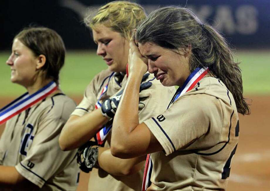 Katy Vandewater feels the sting after getting her medal as O'Connor loses 7-5 to The Woodlands for the state 5A championship in softball at McCombs Field in Austin on June 4, 2011.    Tom Reel/Staff Photo: TOM REEL, Express-News / © 2011 San Antonio Express-News