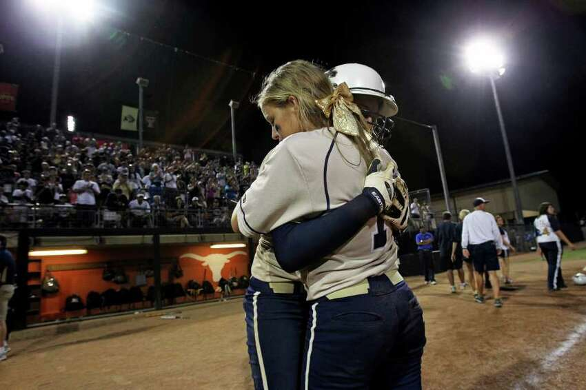 Maegan Ramirez (back) gets a long hug from Courtney Tietze after their season ends as O'Connor plays The Woodlands for the state 5A championship in softball at McCombs Field in Austin on June 4, 2011. Tom Reel/Staff