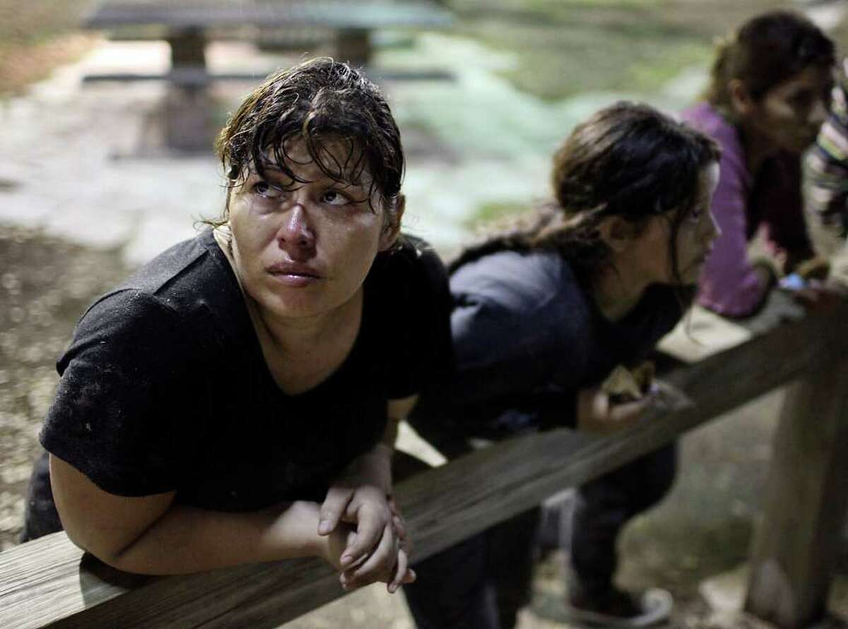 Undocumented immigrants from El Salvador Sandra Marlena Cortillo (from left) her daughter Alizo, 10, sister Anna, and son Bryan, 13, (not pictured) answer questions Friday May 20, 2011 at a rest area near Falfurrias, Tx. (PHOTO BY EDWARD A. ORNELAS/eaornelas@express-news.net)