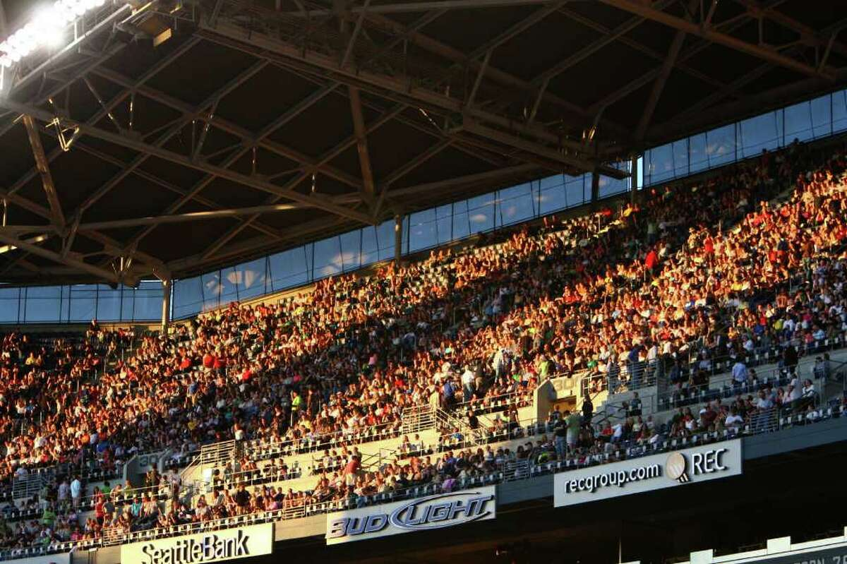 Fans glow in the evening light before U2's 360º Tour performance at Qwest Field in Seattle.