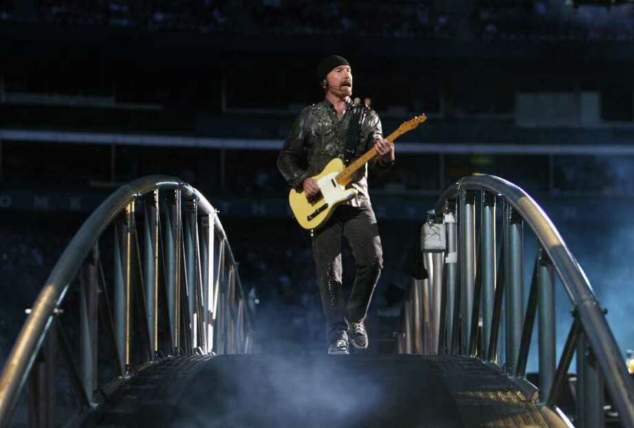 The Edge walks on a bridge over the audience during the band's 360º Tour at Qwest Field in Seattle. Photo: JOSHUA TRUJILLO / SEATTLEPI.COM