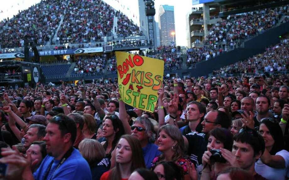 A fan asks Bono for a kiss as U2 takes the stage. Photo: JOSHUA TRUJILLO / SEATTLEPI.COM