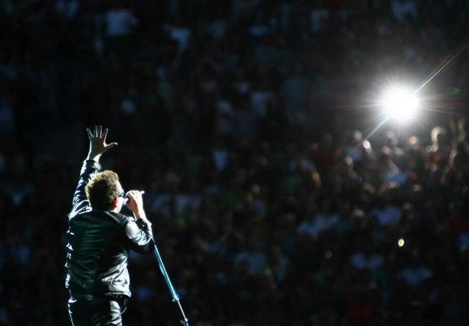 Bono performs to adoring fans during U2's 360º Tour at Qwest Field. Photo: JOSHUA TRUJILLO / SEATTLEPI.COM