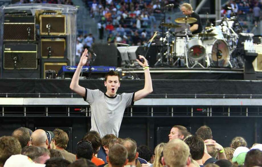 A fan cheers before U2 takes the stage. Photo: JOSHUA TRUJILLO / SEATTLEPI.COM