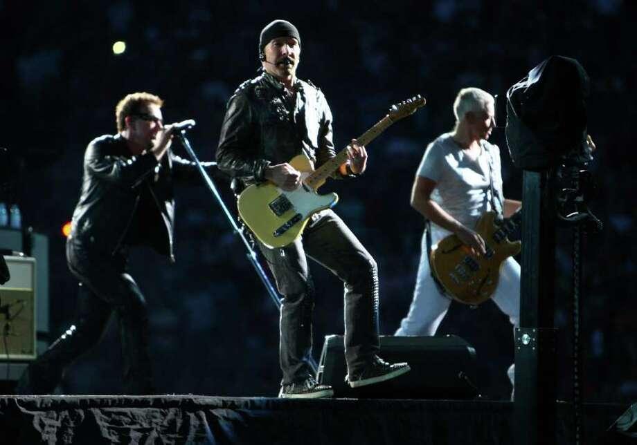 The band U2, from left, Bono, The Edge and Adam Clayton, perform. Photo: JOSHUA TRUJILLO / SEATTLEPI.COM
