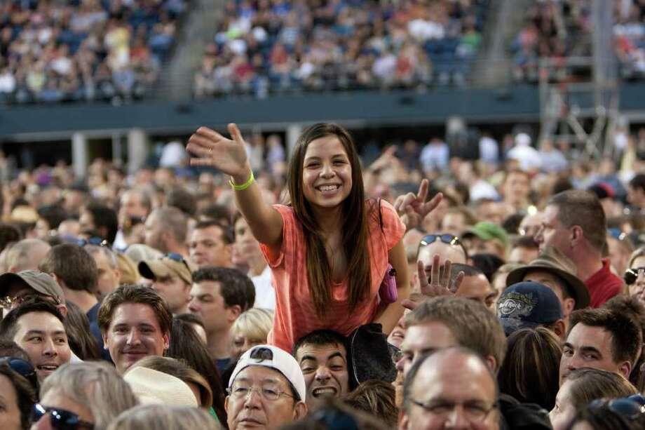 A fan waves before U2 takes the stage. Photo: JOSHUA TRUJILLO / SEATTLEPI.COM