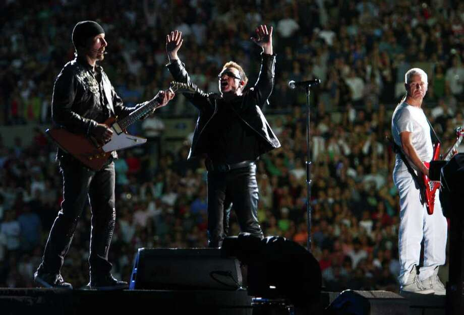 The band U2, from left, The Edge, Bono and Adam Clayton, perform. Photo: JOSHUA TRUJILLO / SEATTLEPI.COM