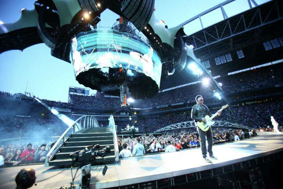 The Edge performs under the band's massive stage, the largest ever toured. Photo: JOSHUA TRUJILLO / SEATTLEPI.COM