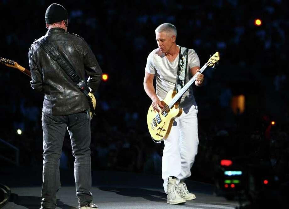 The Edge and bassist Adam Clayton perform. Photo: JOSHUA TRUJILLO / SEATTLEPI.COM