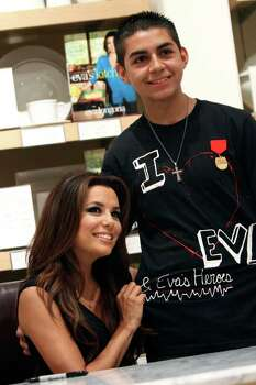 "San Antonio resident Adrian Alegria, right, poses for a picture with Eva Longoria at a book signing for her first cookbook, ""Eva's Kitchen: Cooking with Love for Family and Friends"", June 4, 2011, at Williams-Sonoma at the Shops at La Cantera. Alegria hand made his shirt and said he has been a big fan of the work she does with her charity organizations.  ANDREW BUCKLEY / abuckley@express-news.net Photo: ANDREW BUCKLEY, Andrew Buckley/Express-News / SAN ANTONIO EXPRESS-NEWS"
