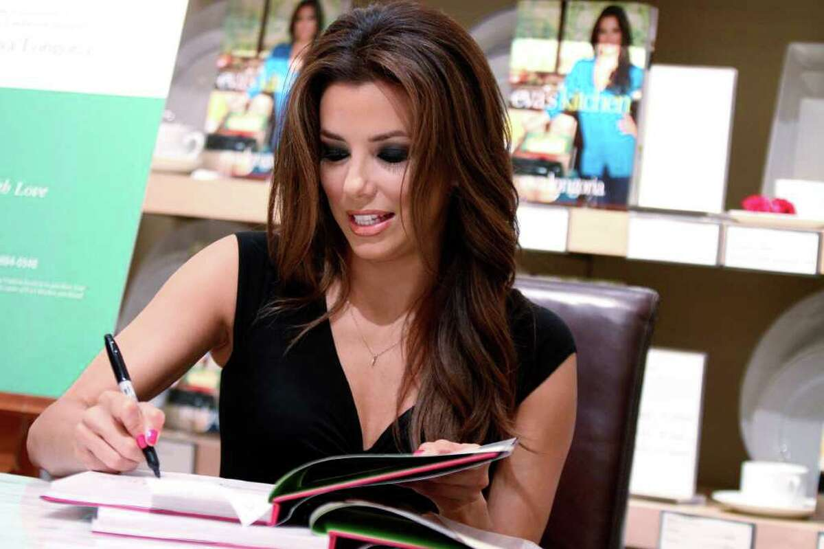 Eva Longoria signs copies of her first cookbook,