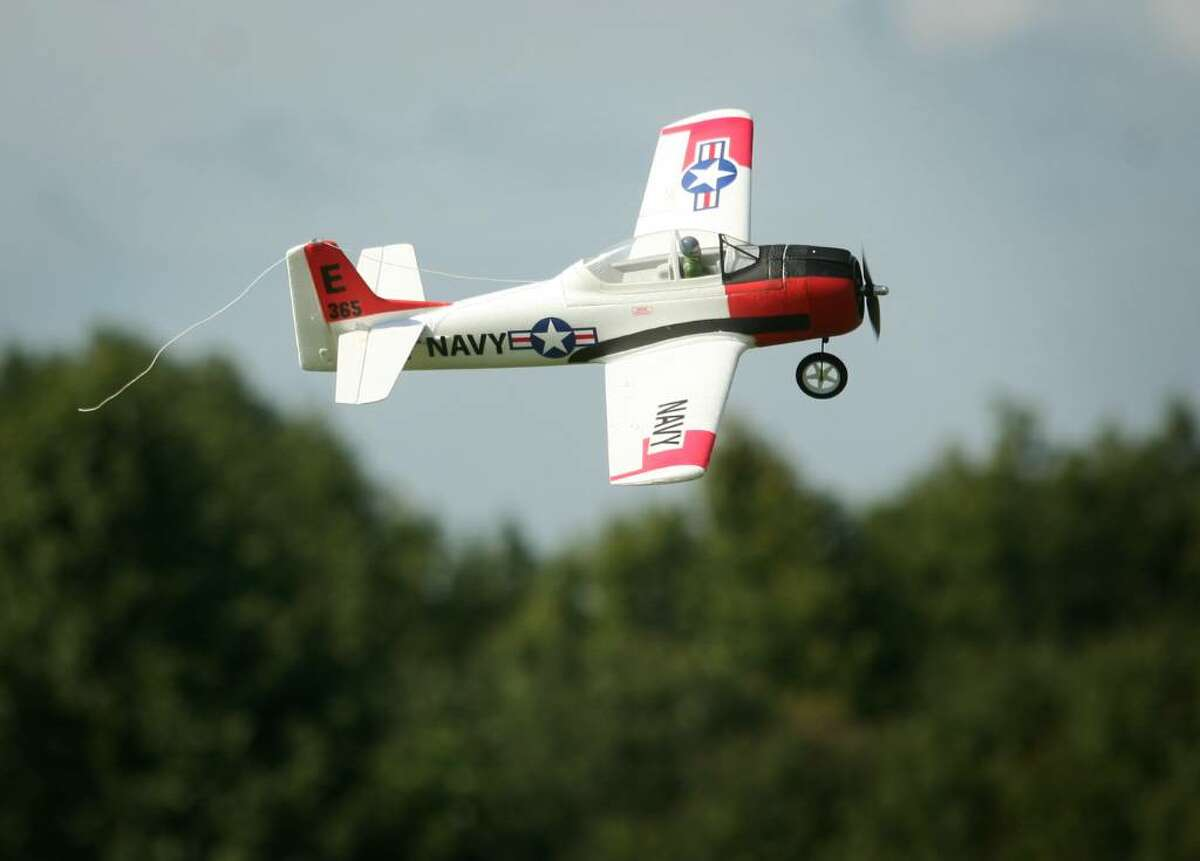 A model of a U.S. Navy T-28 flies over the airfield at the White Hills Eagles Remote Control Airplane Club in Shelton, Conn. on Thursday, September 24, 2009.