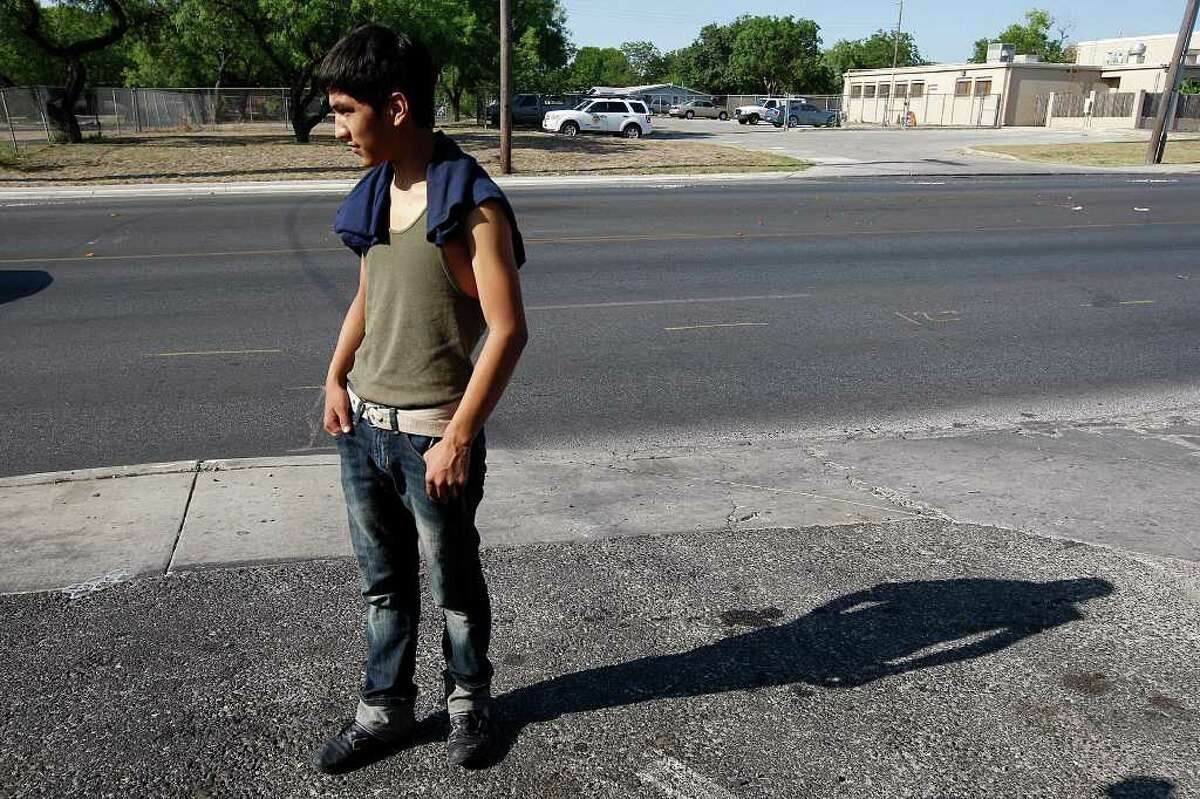 Martin Villarreal, 16, looks over the scene in front of the family's apartment the 4100 block of Culebra Road, on Sunday, June 5, 2011. His 2-year-old nephew, German Alonzo, was struck and killed by cars Saturday night when the boy wandered away from his apartment.