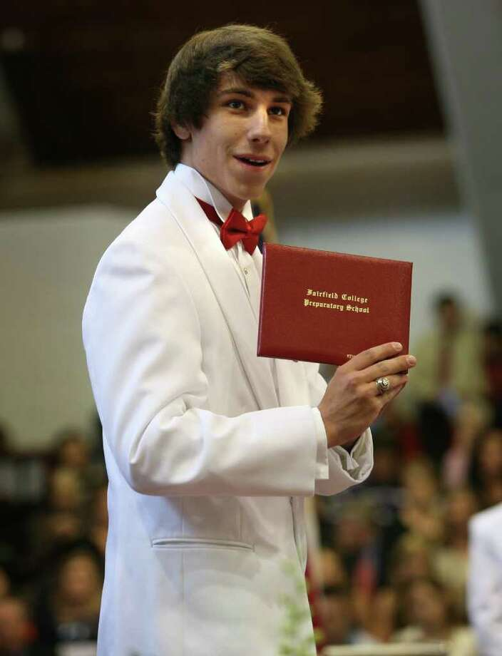 New graduate Kevin Dunkin shows his diploma toward the crowd during Fairfield Prep's Commencement at Fairfield University's Alumni Hall on Sunday, June 5, 2011. Photo: Brian A. Pounds / Connecticut Post