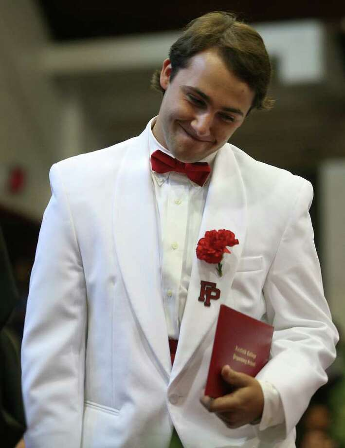 New graduate Michael Smeriglio smiles after receiving his diploma during Fairfield Prep's Commencement exercises at Fairfield University's Alumni Hall on Sunday, June 5, 2011. Photo: Brian A. Pounds / Connecticut Post