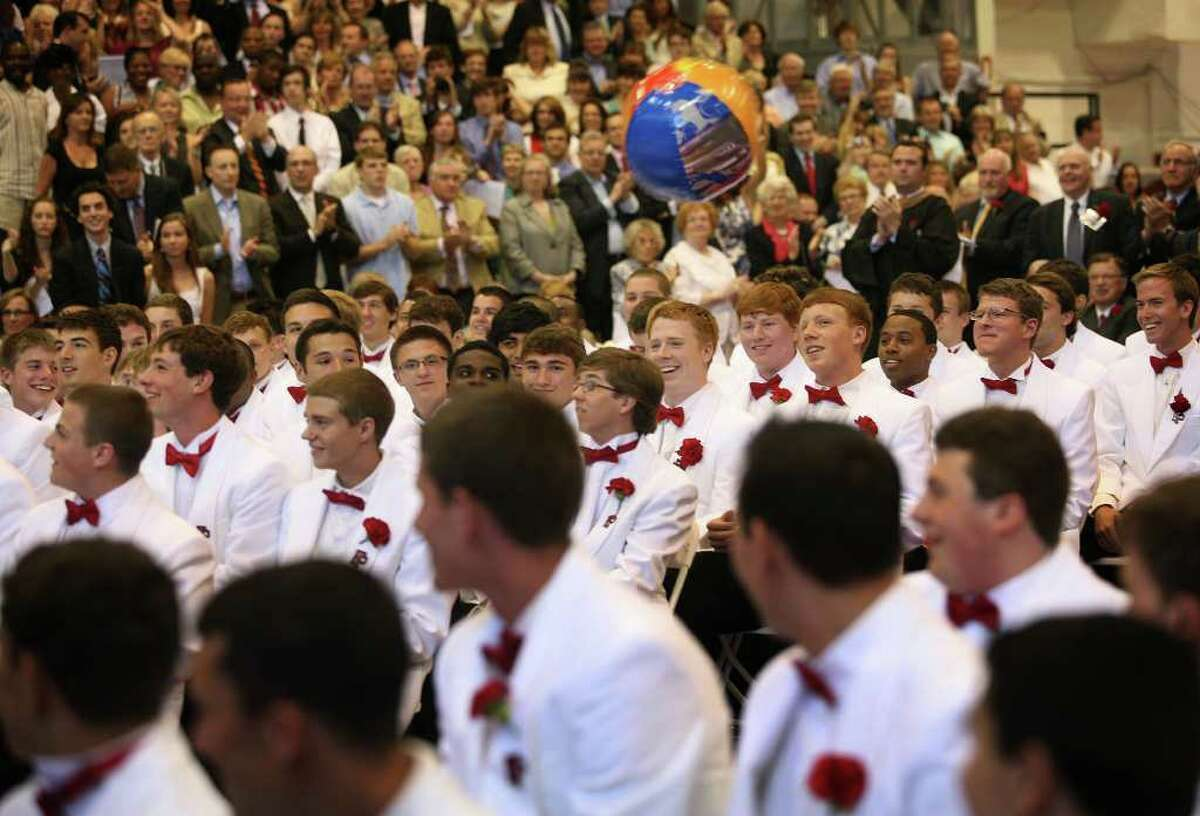 A beach ball is batted around by graduates during Fairfield Prep's Commencement exercises at Fairfield University's Alumni Hall on Sunday, June 5, 2011.