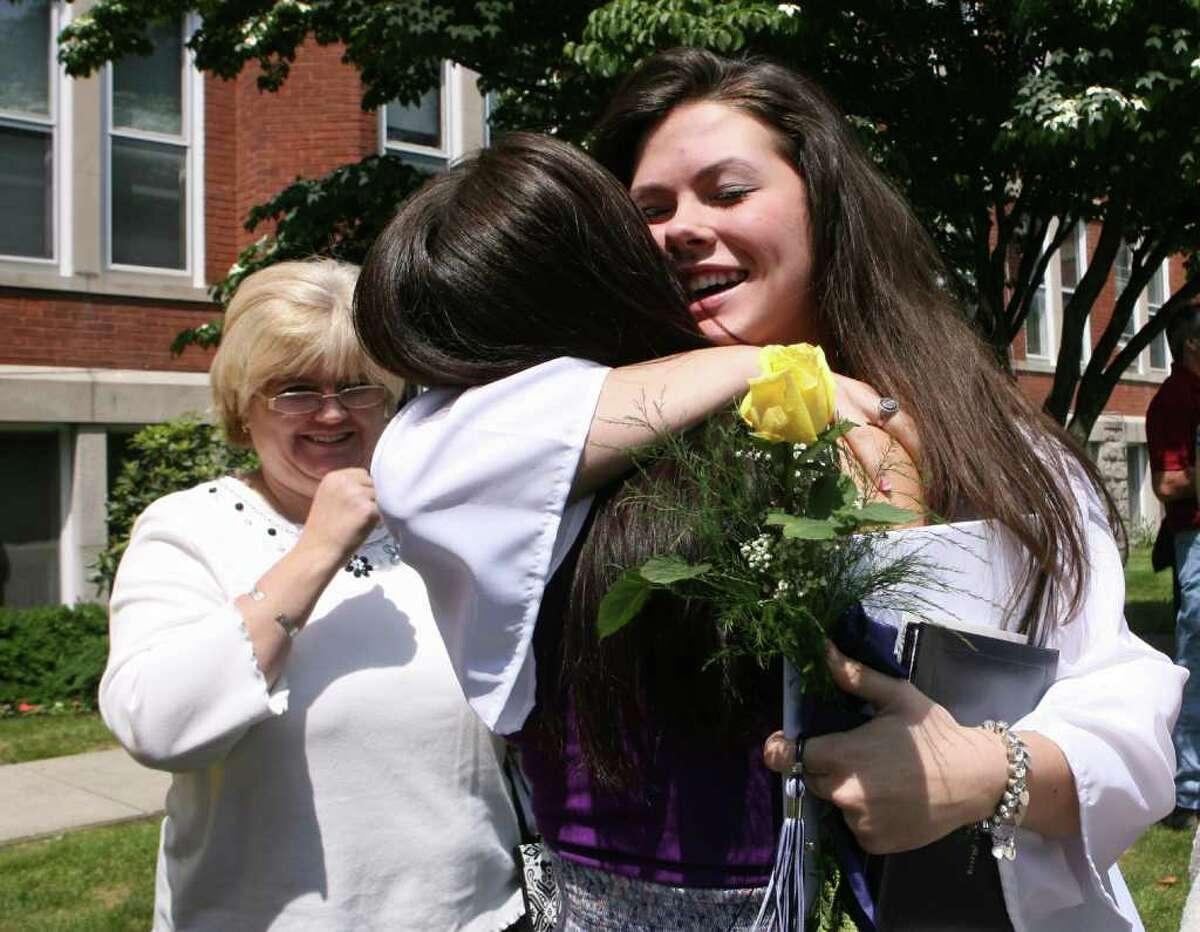 Casey DelBasso, of Orange, hugs her cousin, Taylor Rispoli, of East Haven, after Lauralton Hall's graduation ceremony on Sunday, June 5 , 2011.