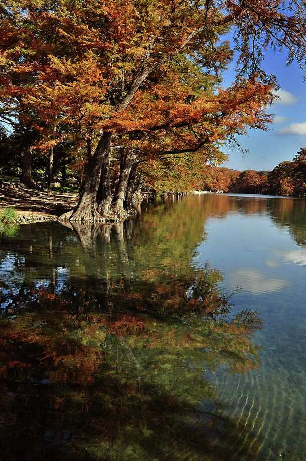 The emerald green waters of the Frio River reflect the vibrant colors of the Cypress trees at Garner State Park. Photo: Laredo Morning Times File Photo / LAREDO MORNING TIMES