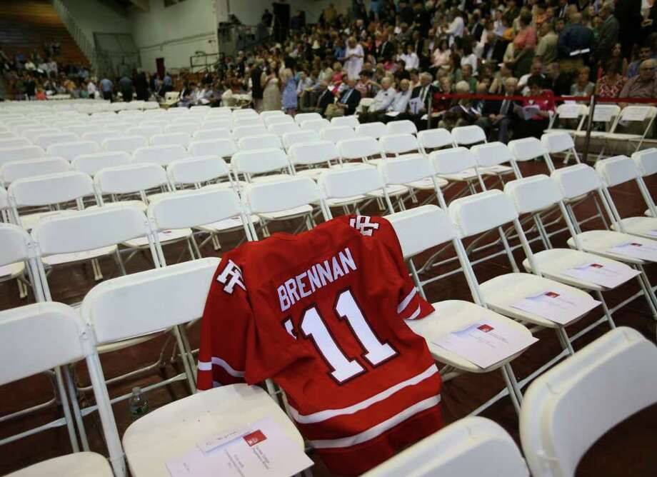 A jersey leaves a space for deceased Fairfield Prep student Ryan Brennan at the Fairfield Prep Commencement ceremony at Fairfield University's Alumni Hall on Sunday, June 5, 2011. Brennan died of cancer in February. Photo: Brian A. Pounds / Connecticut Post