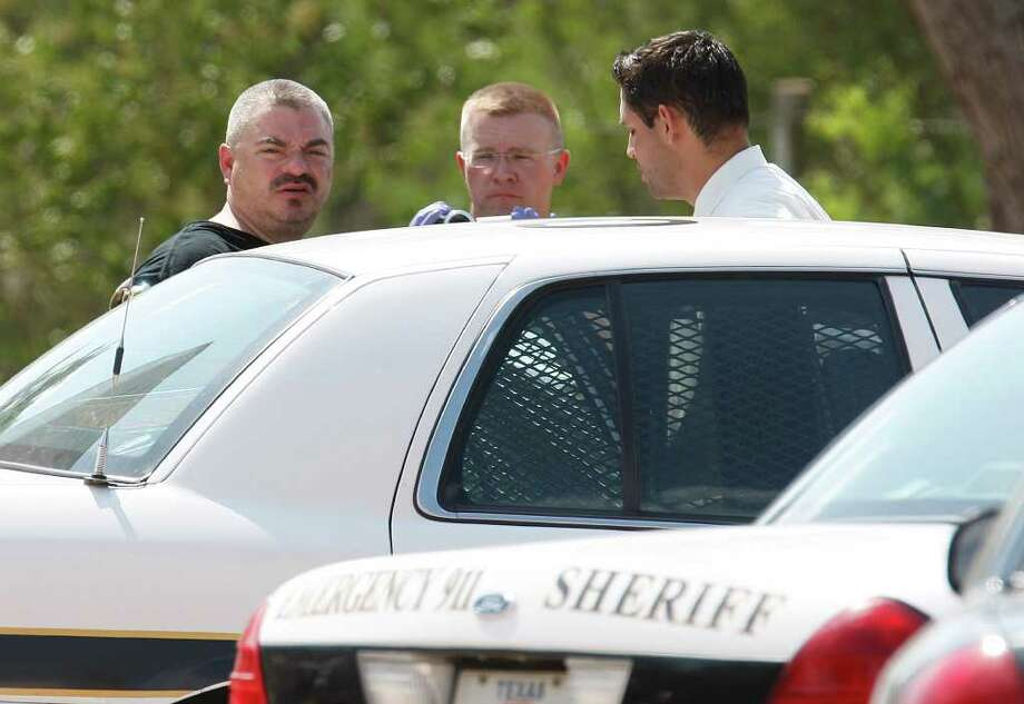 Bexar County Sheriff's officers arrest Mark Anthony Gonzales, 41, the suspect in the capital murder case of Bexar County Sheriff's Sgt. Kenneth Vann, in the 19700 block of Pleasanton Road, on Sunday, June 5, 2011. Photo: Jerry Lara/Express-News / SAN ANTONIO EXPRESS-NEWS