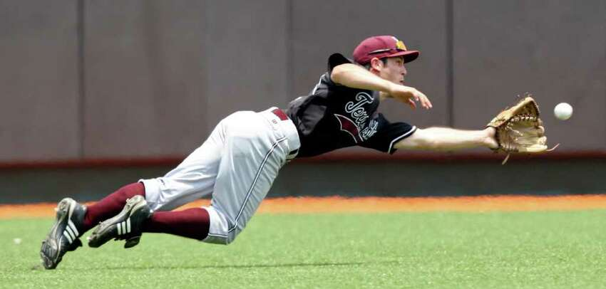 Texas State's Morgan Mickan dives for a ball hit by Texas' Jordan Etier for the out during the second inning.