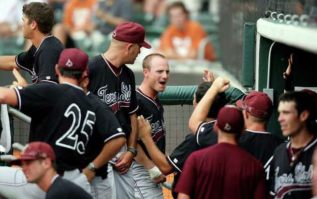 Texas State's Bret Atwood (center) celebrates with teammates after scoring against Texas during the ninth inning. Photo: EDWARD A. ORNELAS, Edward A. Ornelas/Express-News / © SAN ANTONIO EXPRESS-NEWS (NFS)