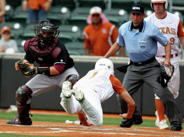 Texas' Cohl Walla dives for home plate against Texas State's Andrew Stumph during the eight inning. Walla was tagged out. Photo: EDWARD A. ORNELAS, Edward A. Ornelas/Express-News / © SAN ANTONIO EXPRESS-NEWS (NFS)