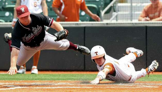 Texas' Jordan Etier scores under Texas State's Fielding Pittman during the sixth inning. Photo: EDWARD A. ORNELAS, Edward A. Ornelas/Express-News / © SAN ANTONIO EXPRESS-NEWS (NFS)