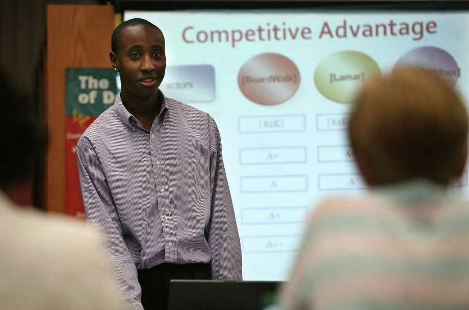 Antan Mills, 16, a junior at Central High School in Bridgeport, presents the plan for his business, Boardwalk advertising, to judges from the local business community as part of the Network for Teaching Entrepreneurship contest. Photo: Brian A. Pounds / Connecticut Post