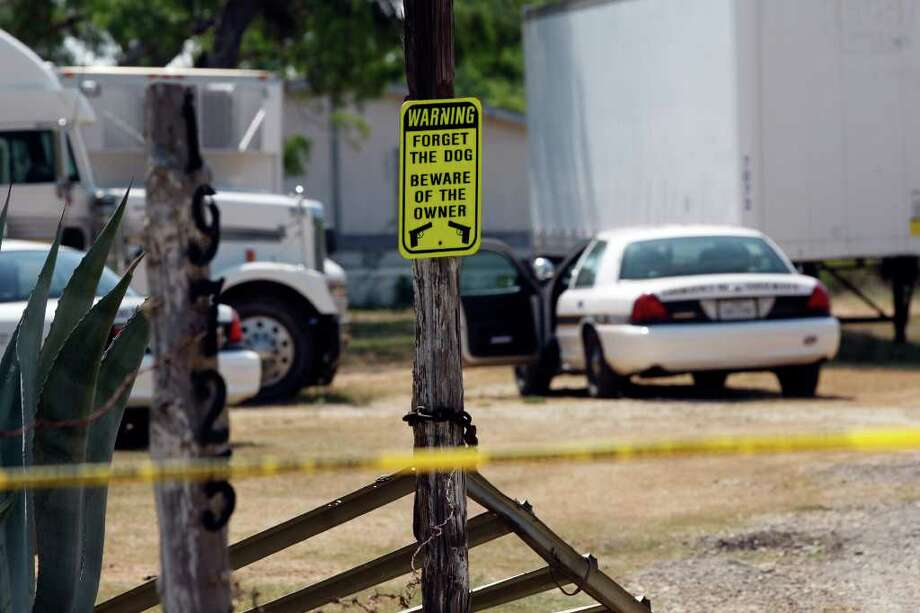 A sign hangs on a post by the entrance to the residence in the 19700 block of Pleasanton Road, where Bexar County Sheriff's officers arrested Mark Anthony Gonzales, 41, as a suspect in the capital murder case of Bexar County Sheriff's Sgt. Kenneth Vann, on Sunday, June 5, 2011. Photo: Jerry Lara/Express-News / SAN ANTONIO EXPRESS-NEWS