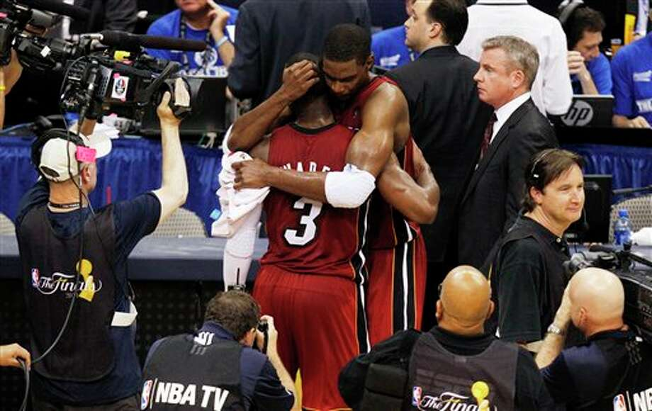 Miami Heat's Dwyane Wade (3) hugs Chris Bosh after the second half of Game 3 of the NBA Finals basketball game against the Dallas Mavericks Sunday, June 5, 2011, in Dallas. The Heat won 88-86 take a 2-1 lead in the series. (AP Photo/LM Otero) Photo: Associated Press