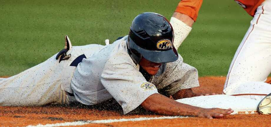 Kent State's Derek Toadvine slides safely into third base around the tag of Texas' Erich Weiss during the third inning. Photo: Edward A. Ornelas/Express-News / © SAN ANTONIO EXPRESS-NEWS (NFS)