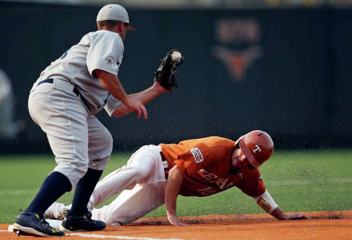 Texas' Brandon Loy steals third base under Kent State's Travis Shaw during the first inning.