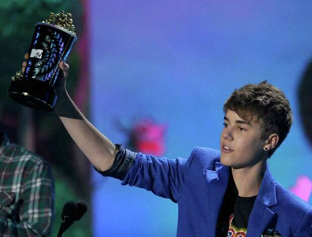 UNIVERSAL CITY, CA - JUNE 05:  Singer Justin Bieber accepts the Best Jaw-Dropping Moment award onstage during the 2011 MTV Movie Awards at Universal Studios' Gibson Amphitheatre on June 5, 2011 in Universal City, California. Photo: Kevin Winter, Getty Images / 2011 Getty Images