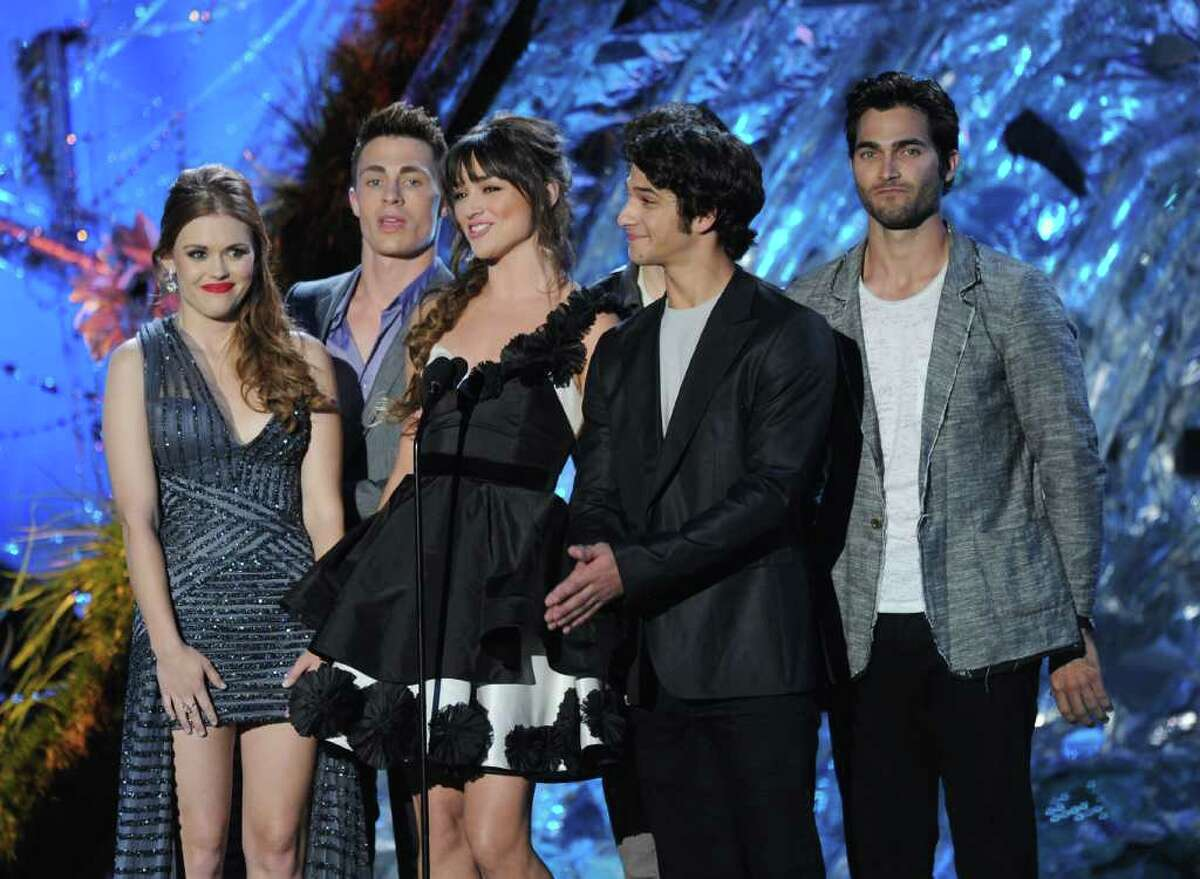 Actors (L-R) Holland Roden, Colton Haynes, Crystal Reed, Tyler Posey, and Tyler Hoechlin onstage during the 2011 MTV Movie Awards at Universal Studios' Gibson Amphitheatre in Universal City, Calif., on Sunday, June 5, 2011.