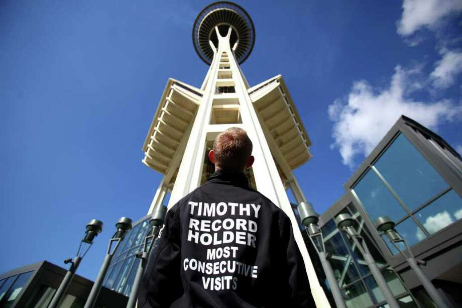 Timothy Clemans looks up at Seattle's Space Needle before his 103rd trip to the top of the icon. Clemans holds the record for the most consecutive visits to the top of the Space Needle. Photographed on June 3, 2011. Photo: JOSHUA TRUJILLO / SEATTLEPI.COM