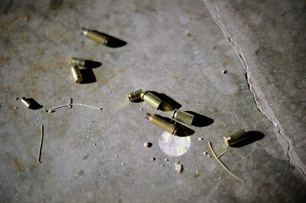 TUCSON, AZ - JANUARY 15:  Empty bullet casings lie on the concrete floor of Southwest Regional Park shooting range near the Crossroads of the West Gun Show at the Pima County Fairgrounds on January 15, 2011 in Tucson, Arizona. Today marks one week since Jared Lee Loughner killed six and injured several others, including U.S. Rep. Gabrielle Giffords (D-AZ), who he shot in the head with a 9-millimeter Glock semiautomatic pistol and who remains in critical condition. (Photo by Kevork Djansezian/Getty Images) Photo: Kevork Djansezian, Getty Images / 2011 Getty Images