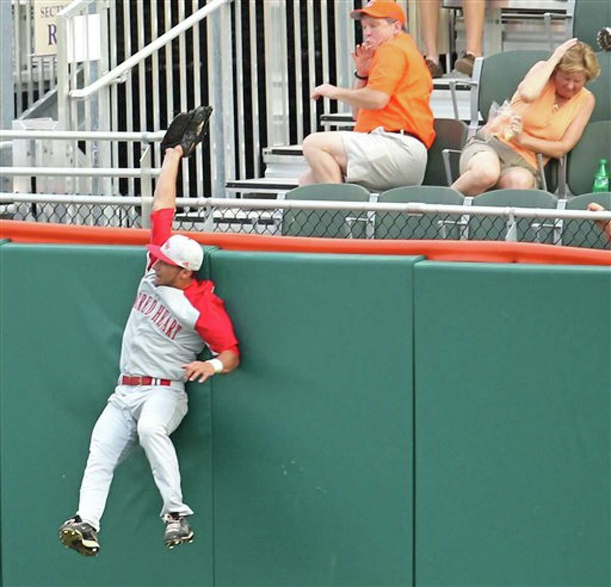 Sacred Heart right fielder Dave Boisture makes a leaping catch at the fence as he robs Clemson batter Richie Shaffer of a home run during an NCAA college baseball tournament game at Doug Kingsmore Stadium in Clemson, S.C. on Friday, June 3, 2011. (AP Photo/Anderson Independent-Mail, Mark Crammer)