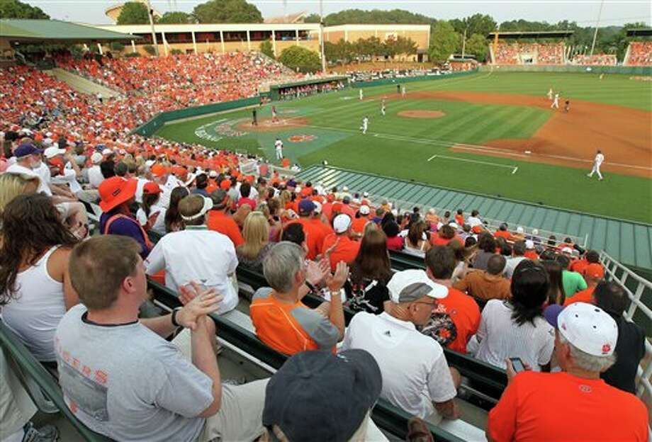 Over 5,100 fans watch an NCAA college baseball tournament game between Sacred Heart and Clemson at Doug Kingsmore Stadium in Clemson, S.C., Friday, June 3, 2011. (AP Photo/Anderson Independent-Mail, Mark Crammer) Photo: AP