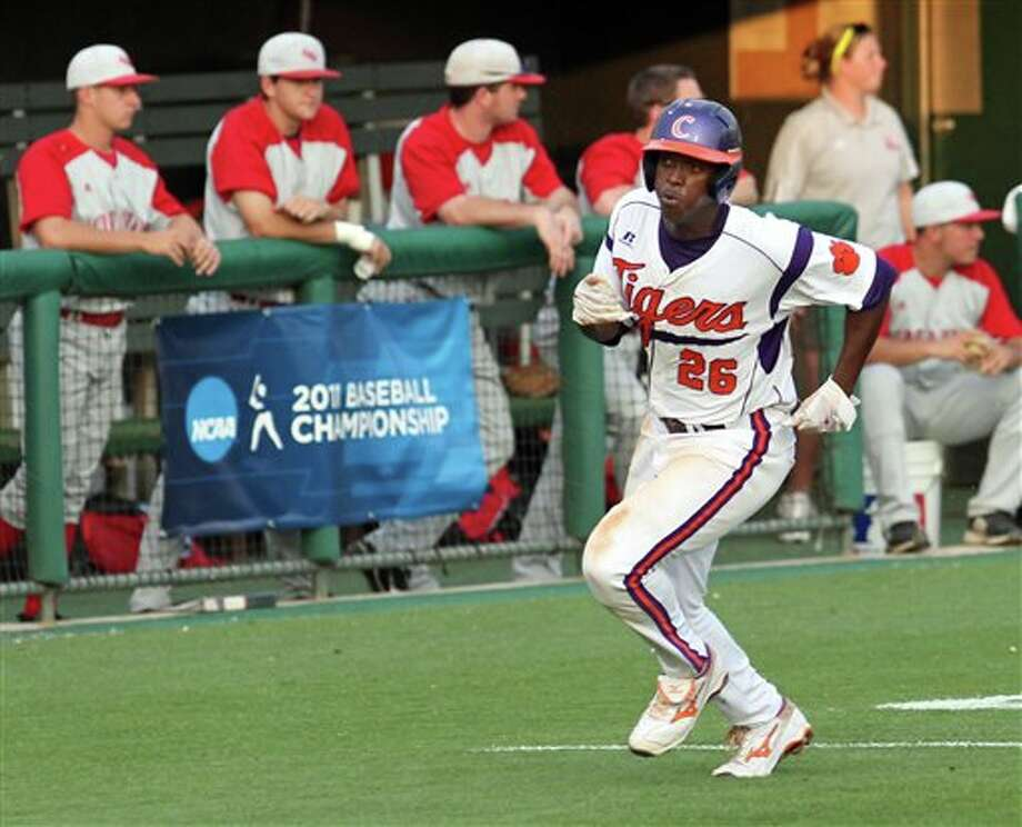 Clemson's Chris Epps runs home for a score during an NCAA college baseball tournament game against Sacred Heart at Doug Kingsmore Stadium in Clemson, S.C., Friday, June 3, 2011. (AP Photo/Anderson Independent-Mail, Mark Crammer) Photo: AP