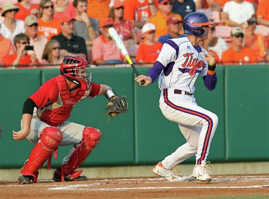 Clemson batter Brad Miller, right, watches the ball after hitting an RBI-single during an NCAA college baseball tournament game against Sacred Heart at Doug Kingsmore Stadium in Clemson, S.C., Friday, June 3, 2011. (AP Photo/Anderson Independent-Mail, Mark Crammer) Photo: AP