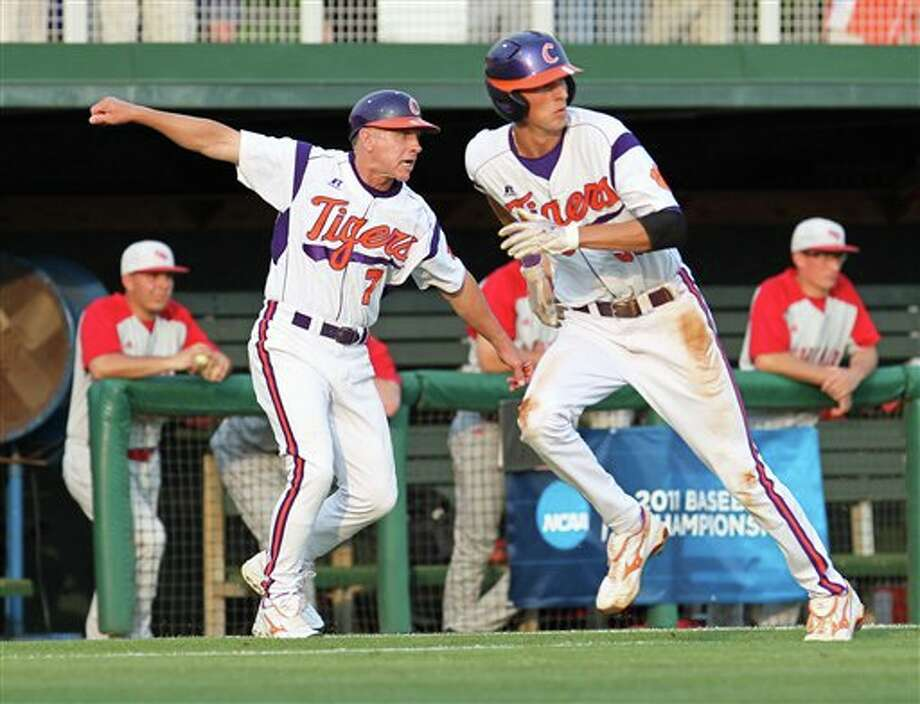 Clemson coach Jack Leggett, left, signals Will Lamb home from third base during an NCAA college baseball tournament game against Sacred Heart at Doug Kingsmore Stadium on Friday, June 3, 2011, in Clemson, S.C. (AP Photo/Anderson Independent-Mail, Mark Crammer) Photo: AP
