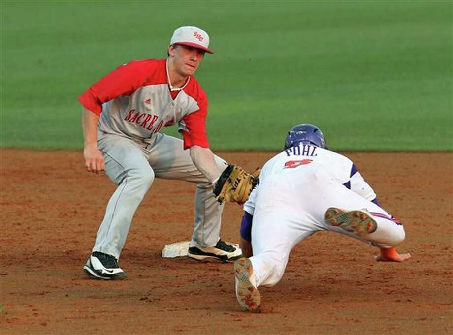 Sacred Heart shortstop John Murphy, left, waits to tag out Clemson runner Phil Pohl as he attempts to steal second during an NCAA college baseball tournament game at Doug Kingsmore Stadium on Friday, June 3, 2011,in Clemson, S.C. (AP Photo/Anderson Independent-Mail, Mark Crammer) Photo: AP