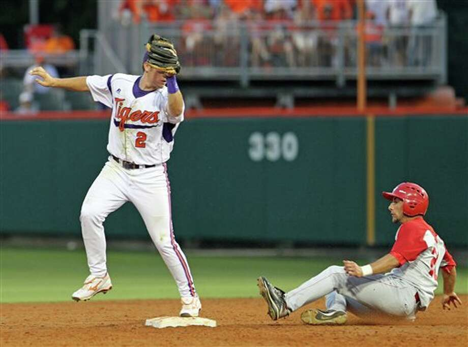 Clemson second baseman Jason Stolz, left, gets the force out on Sacred Heart runner Dave Boisture during an NCAA college baseball tournament game at Doug Kingsmore Stadium, Friday, June 3, 2011, in Clemson, S.C. (AP Photo/Anderson Independent-Mail, Mark Crammer) Photo: AP