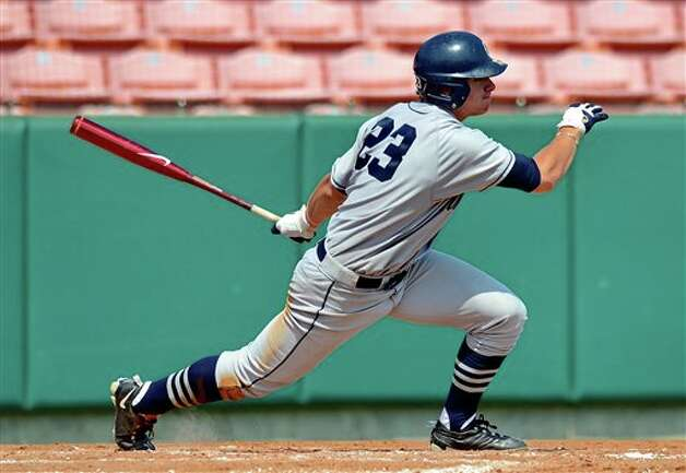 Connecticut's John Andreoli hits a double against Sacred Heart during an NCAA Clemson regional college baseball game at Doug Kingsmore Stadium in Clemson, S.C. Saturday, June 4, 2011. (AP Photo/ Richard Shiro) Photo: AP