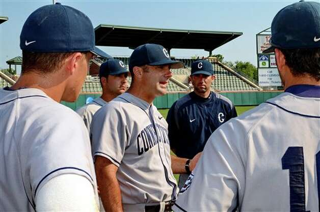 Connecticut head coach Jim Penders talks with  his team after their 13-3 win over Sacred Heart at an NCAA Clemson regional college baseball game at Doug Kingsmore Stadium in Clemson, S.C. Saturday, June 4, 2011. (AP Photo/ Richard Shiro) Photo: AP