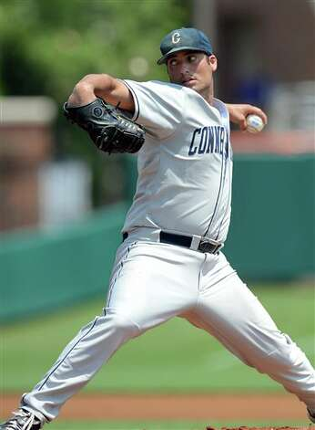 Connecticut's starting pitcher Greg Nappo works against Sacred Heart during an NCAA Clemson regional college baseball game at Doug Kingsmore Stadium in Clemson, S.C. Saturday, June 4, 2011. (AP Photo/ Richard Shiro) Photo: AP