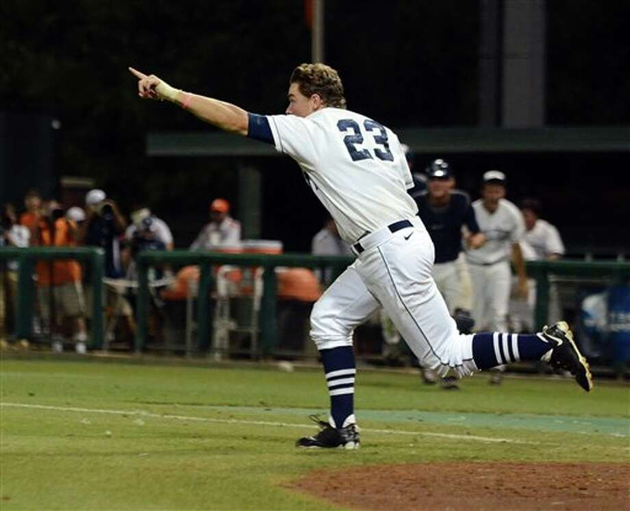 Connecticut's John Andreoli celebrates their 7-6 win over Clemson during an NCAA college baseball regional tournament game against Clemson at Doug Kingsmore Stadium Sunday, June 5, 2011, in Clemson, S.C. (AP Photo/ Richard Shiro) Photo: AP